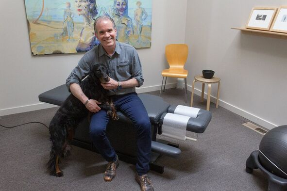 Dr. Leitner and his dog.